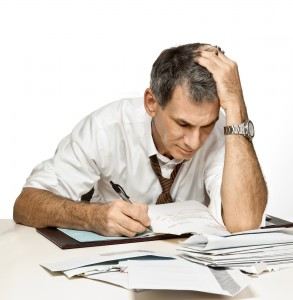 bigstock-Man-Paying-Bills-And-Worrying-6334851-293x300